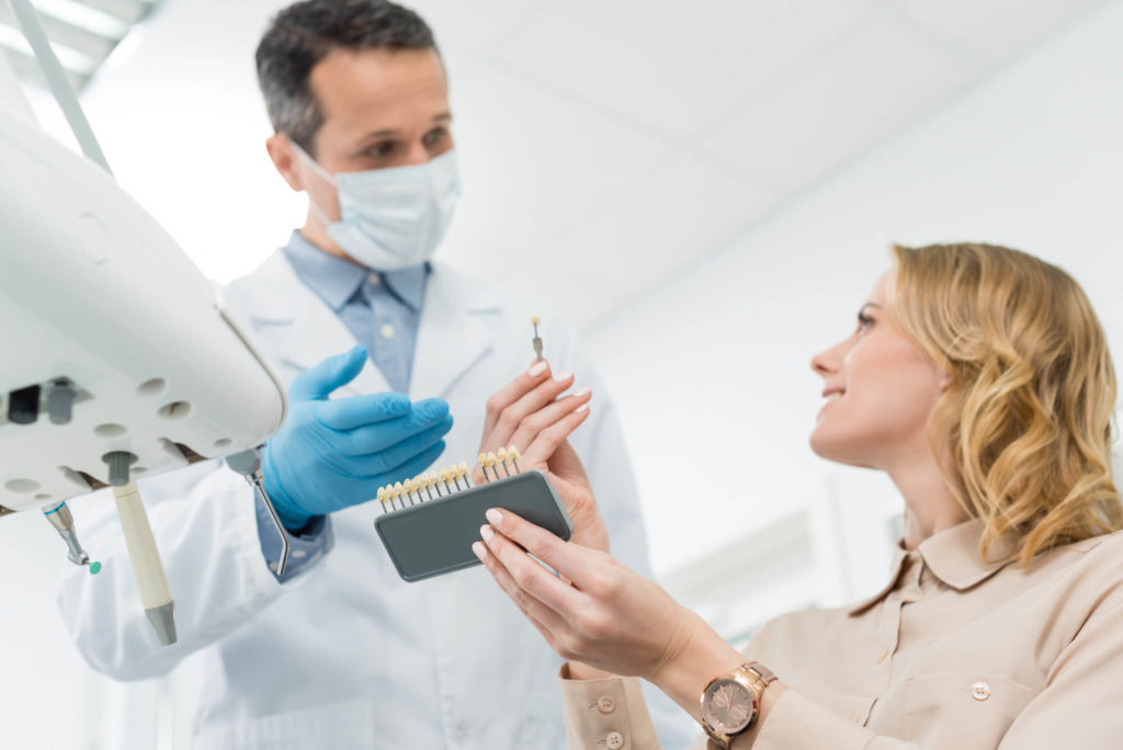Dentist showing patient the Best Dental Implants in Naples
