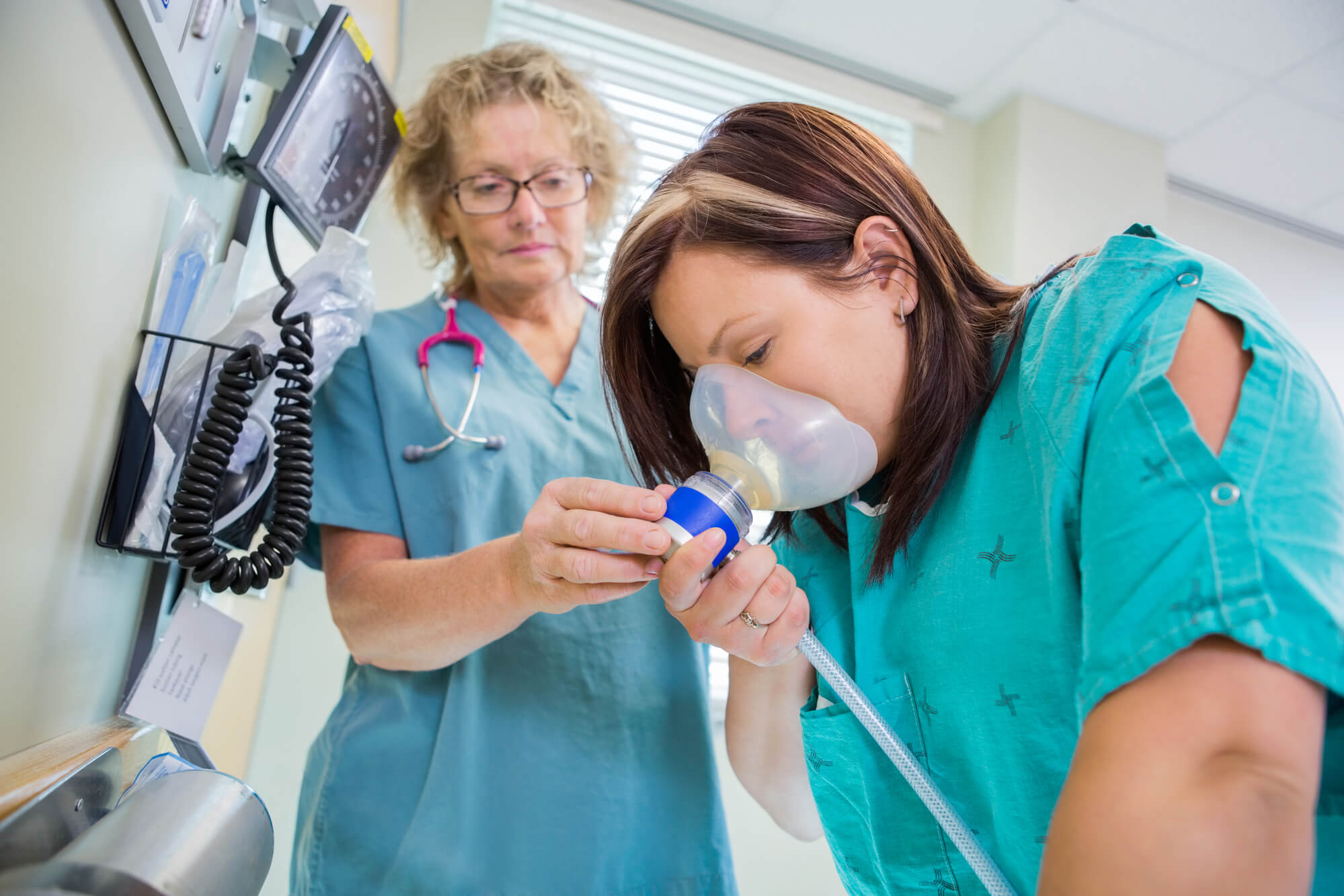 nitrous oxide dentist in Naples assisting a patient to calm down